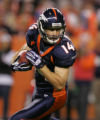 Denver Broncos Brandon Stokely, turns upfield on his touchdown against the Tennessee Titans   in...