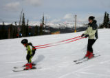 Alex Kovac, 5, left, on a run with his mom, Michelle Kovac (cq), Wednesday afternoon, December 5,...