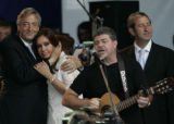 XNP103 - Argentine composer and producer Gustavo Santaolalla, second right, sings during a music...