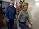 DM1919   Security Guard Jeanne Assam, 42, is led out of a press conference by Pastor Brady Boyd,...