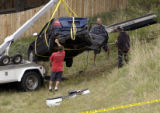 (Arapahoe County, CO., SEPTEMBER 10, 2004) Wrecker operators remove the car which crashed down a...