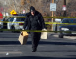 Denver Police remove evidence from  the scene of a deadly shooting which happened an apartment...