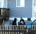 Erik Lozada (cq) Janelle Maestas (cq) leave their apartment as Denver Police investigate the scene...