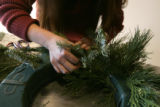 4. How to make a wreath with Denise Capelli at Capelli Floral:  Poke the greens into the wreath...