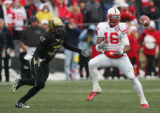 Maurice Purify bobbles a pass that was intercepted by Cha'pelle Brown in the fourth quarter of CU...