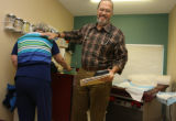 Dr. Jim Williams (cQ) pats his patient on the back, after Cris Jewell came in for her regular...
