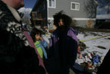 0120 Savannah Deleon, 9, right, came with her sister, Juliana Deleonn, 6, center, and her mother,...