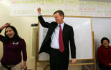 From left-Hermimia Moreno, of Metro Organizations for People, and Mayor John Hickenlooper, cheer...