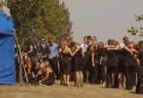 (BEATRICE, Nebraska, September10, 2004) As the cemetery services concluded and many left, a number...