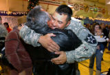 Wednesday, November 27, 2007-photo by Jerilee Bennett-Sgt. Nelson Grizales, Jr. is greeted by his...