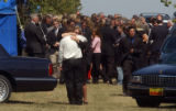 (BEATRICE, Nebraska, September10, 2004) A farewell emotional hug from two of the mourners at the...