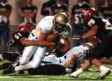 Boulder, Colo., photo taken Sept. 10, 2004- Legacy RB, Joey Applehens (#8 white jersey) is stopped...