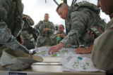 Major Andrew Olmsted reviews the target areas along with his unit, as they work closely with...