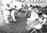 Chef Paul Prudhomme explained his philosophy of cooking to a gathering of writers as little Nell...