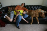 Danny Hoffenberg, 10, (cq) has had two heart transplants. He gets portraitized on his couch with...