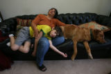 Danny Hoffenberg, 10, (cq) has had two heart transplants. He is portraitized on his couch with his...