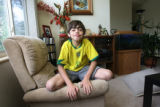 Danny Hoffenberg, 10, (cq) has had two heart transplants. He plays for portraits at his home in...