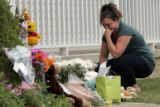 After dropping off some flowers in front of the home of Jessie Davis, Teresa Griffin, of North...
