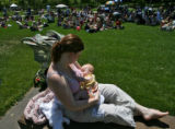 Heather Wilcox nurses her 5-month-old daughter Rachel during the National Mile High Breastfeeding...