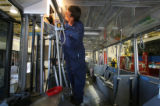 Don Mikita, cq, RTD service mechanic, works on a door motor retrofit on one of RTD's 16th Street...