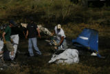 DLM0915  Recovery workers from Beegle's Aviation pick up the charred remains of a single engine...