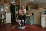 "Masatomi ""John"" Yonekura (cq) in his one chair barbershop in Denver, Colo. at 2049..."