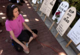 (Boulder, Colo., September 12, 2004) Isabelle Andre, of Boulder, prays next to a group of replica...