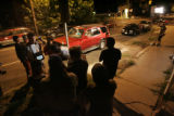 "Film crews set up a scene during the filming of ""Suburban"" at Don's Mixed Drinks in..."