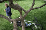 NOT A REAL ASSIGNMENT - DO NOT PUBLISH   Robert Meyer of Denver leans his bike against a tree at...