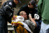 CODER106 - Davis Seals, 34, of Kansas is wheeled to a waiting ambulance Tuesday June 12, 2007,...