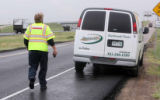 Evan Williams (cq) a courtesy-patrol  driver for E470 helps driver Robert Miller (cq) on E470 near...
