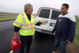 l to r: Evan Williams (cq) a courtesy-patrol  driver for E470 , helps stranded motorist Robert...