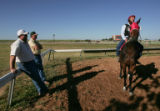 (L-R) Shannon Rushton (cq) and his father Temple Rushton (cq)  a trainer at Arapahoe Park,  joke...