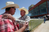 (L-R) Shannon Rushton (cq) Executive Director of the Colorado Horse Racing Association, talks with...
