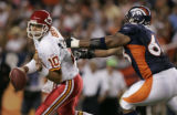 (DENVER, COLO., SEPTEMBER 12, 2004) - Kansas City Chiefs' #10, Trent Green, left, steps out of the...