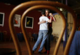 DLM5577  Tango instructor Chas Gale dances with client Ann Dobyns at his studio in Denver, Colo....