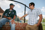 Vanderbilt pitcher David Price, left, and teammate Casey Weathers, right, talk to eachother during...