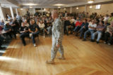 0494 Concerned members of the public attend a meeting held by the U.S. Army LTC James Rice, in...