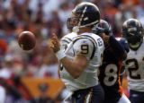 (Denver, Colo., on Sunday night, Sept. 26, 2004) Denver Broncos Kenoy Kennedy forces a fumble by ...