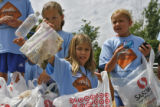 DLM0594   Megan Schmitt, 10, from left, Jessie Murphy, 9, and Kyra Radtke, 10, look at all the...