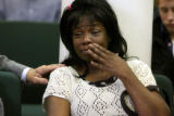 Eugenia Hamelin (cq),47, cries during a meeting of the annual winter homeless report at the state...