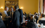 Rep. Doug Lamborn, R-Colo., left, stops to talk briefly with former Rep. Scott McGuinnis, right,...