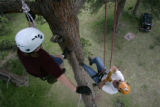 Chris Hanson,(cq) left, of Morrison, Colo., and Harv Teitelbaum (cq) of Evergreen, Colo., climb a...