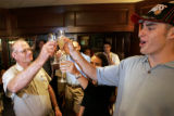 Jack Smith, left, father of CSU's Jason Smith, right, presents a toast as they celebrate his first...