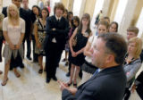 Rep. Doug Lamborn, R-Colo., right, talks to a Colorado Rural Electric Assoc. youth tour in the...