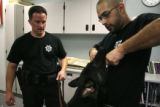 Jefferson County Deputy Sheriff Troy Gardalen(cq) listens and watches as police dog trainer Donnie...