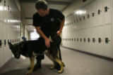 Jefferson County Deputy Sheriff Troy Gardalen(cq) pats Ike, a German Shepherd from the Czech...