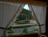 The small town of Deckers seen through a window of a South Platte River Cabin, Wednesday...