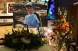 Flowers and a photo of 8 year old Quinton Von Duyke,  adorn the alter Friday, June 29, 2007 at...