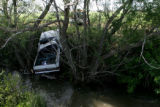 A Chevy Blazer is removed from a creek Friday June 15, 2007, as the Colorado State Patrol...